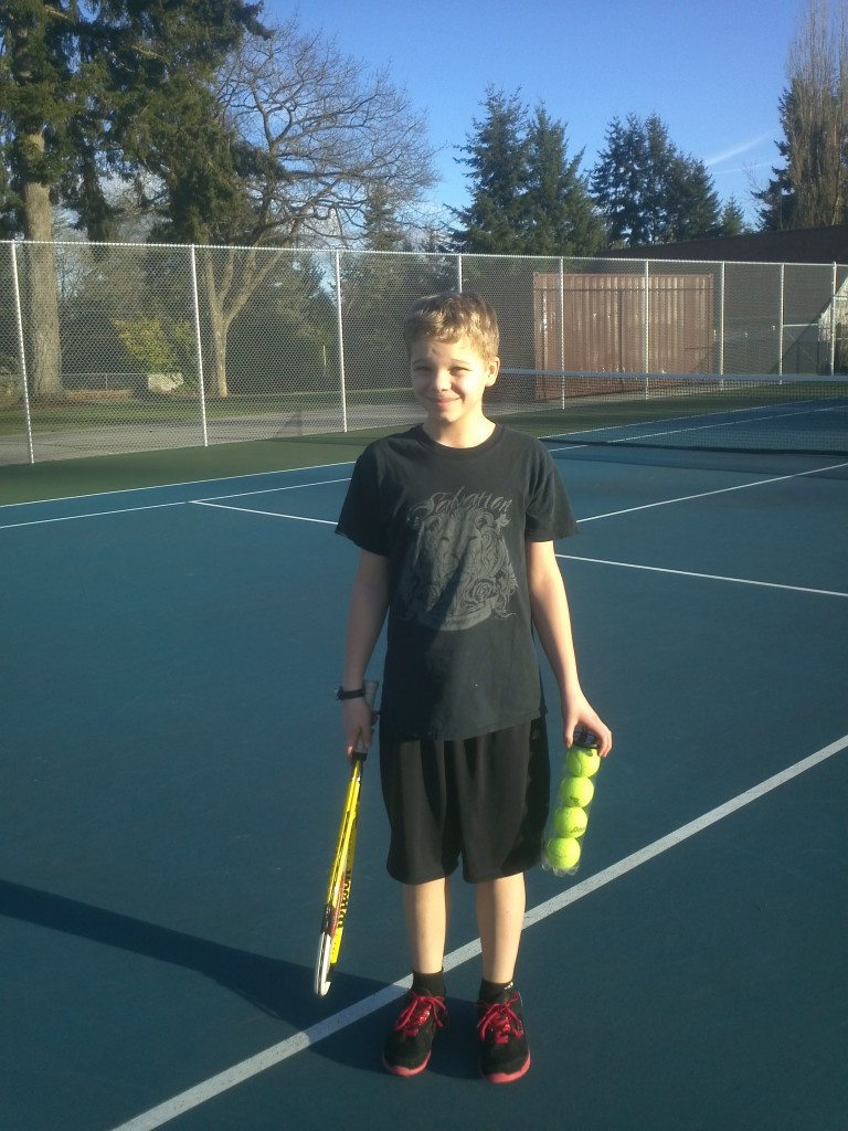 Don't let the innocent expression fool you -- this kid wields a diabolical raquet.