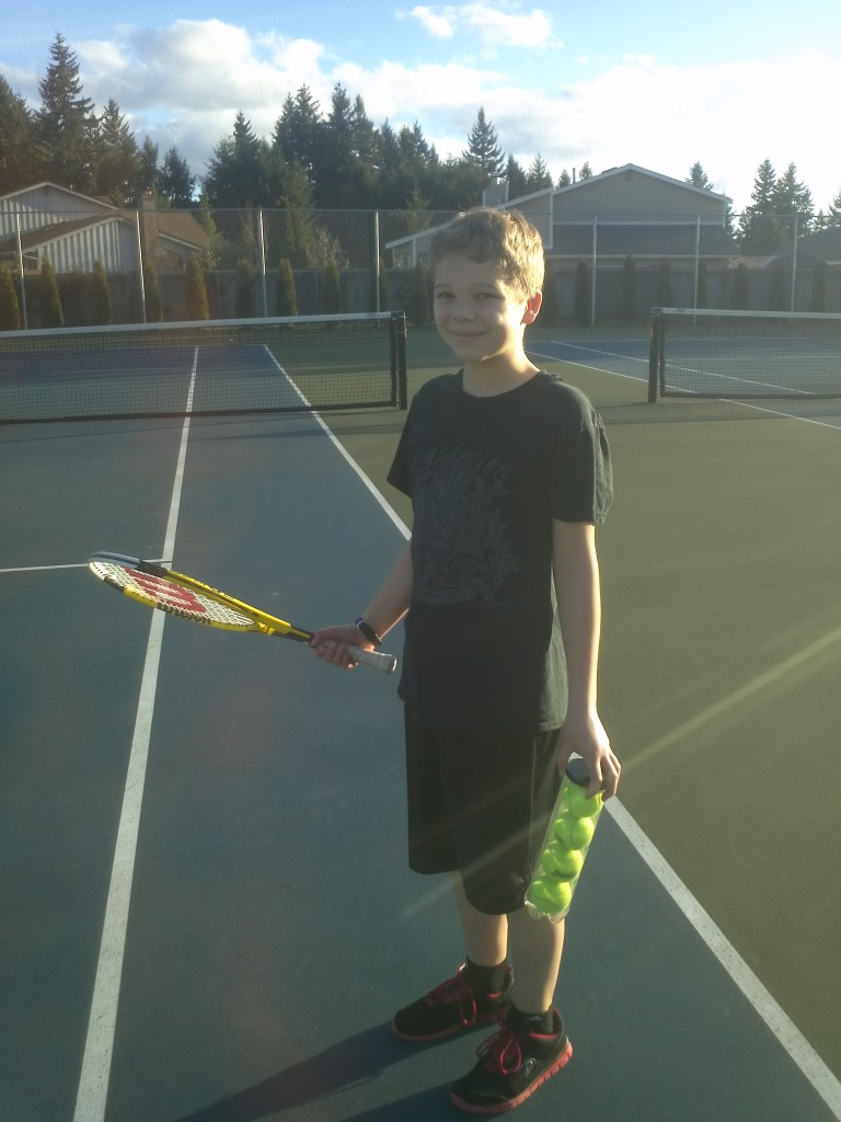 David the Tennis Pro stands ready