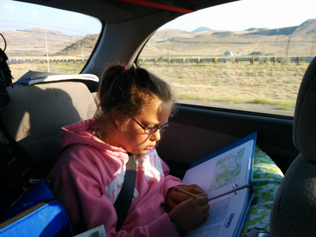 Sarah worked steadily on her Road Trip Activity binder -- and she takes her responsibilities as Navigator very seriously.