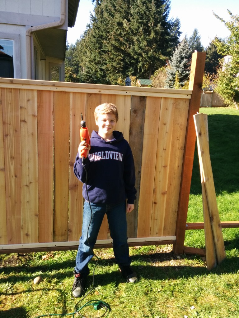 Our backyard fence fell apart, and I promised Kathy I would repair it 'this summer'.  As the November rains set in, it is still only about 2/3 finished.  But I'm thankful for the cheerful and willing help of my youngest son, who blesses us with his willing service.