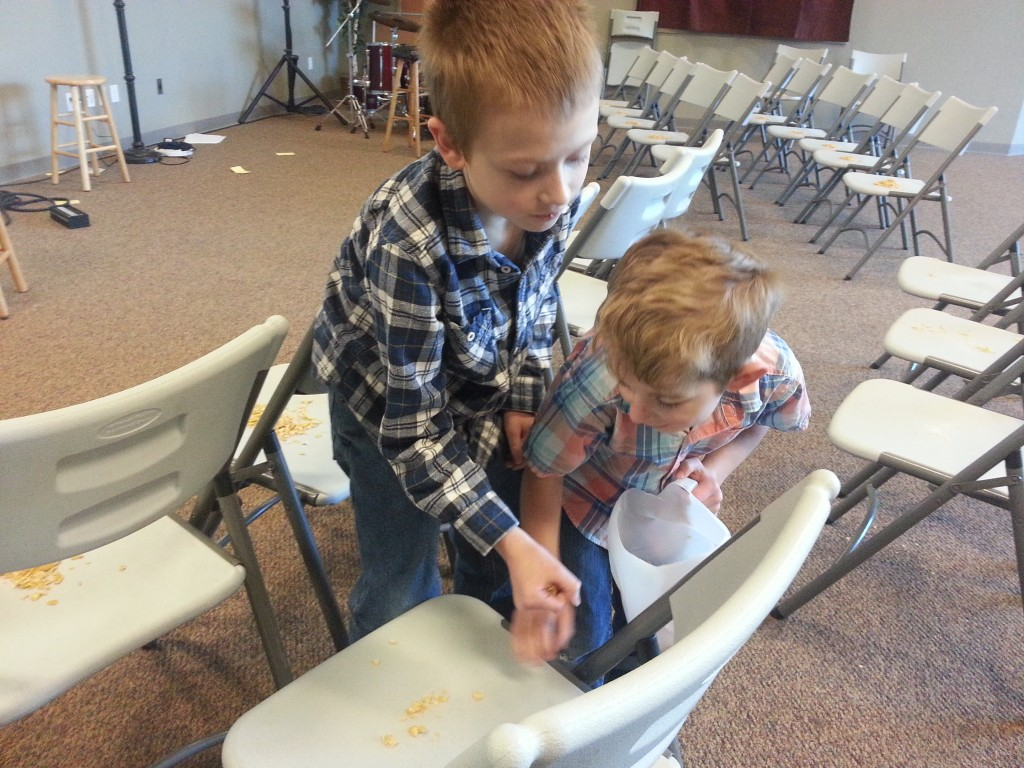 Nathaniel and Cooper were eager to gather the flakes from the chairs.