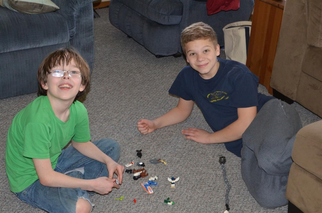 """""""Mom, it's really more fun playing with toys than working on silly AWANA paperwork."""""""