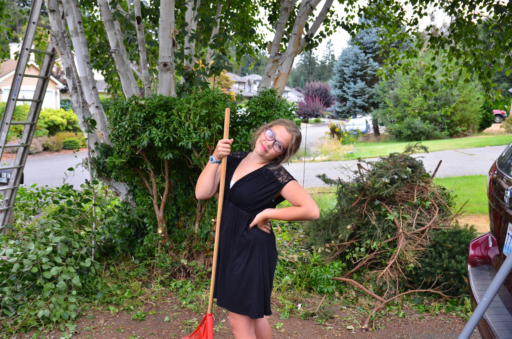 Lawn work is not Sarah's favorite -- she is better at looking beautiful.