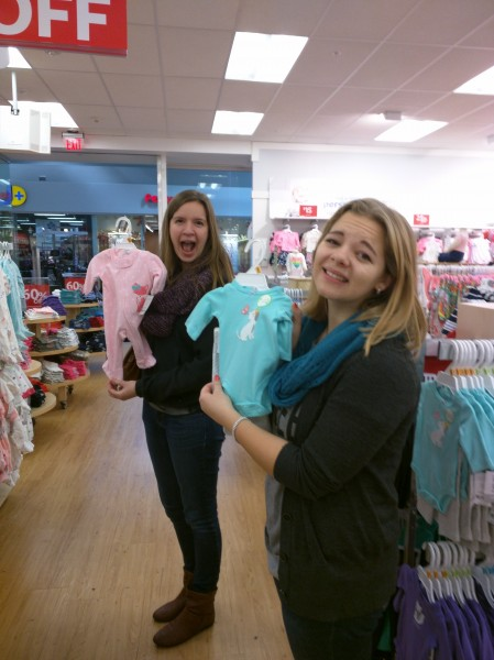 Rachel and Jenny oohing over some baby pajamas