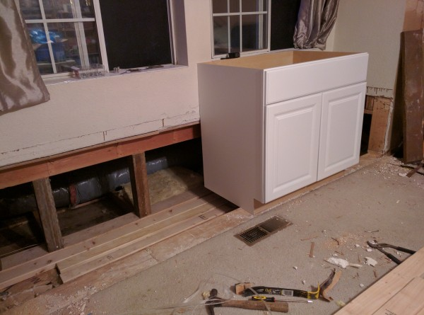 The cabinet looks tall because I haven't yet cut off the bottom and fit it into the recess of the window seat.