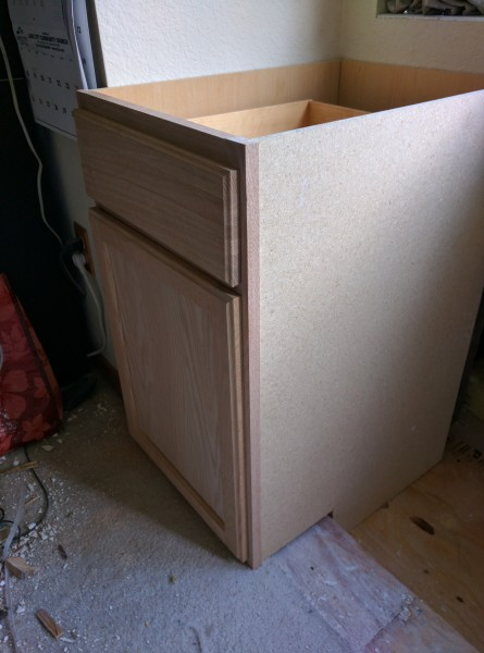 I admit, the unfinished cabinets will probably work a lot better with the overall decor of the bedroom.