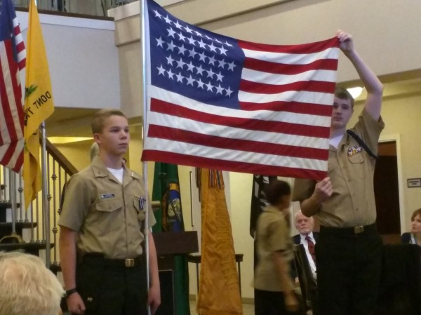David in his standard uniform, participating in a Military Order of the World Wars flag event.