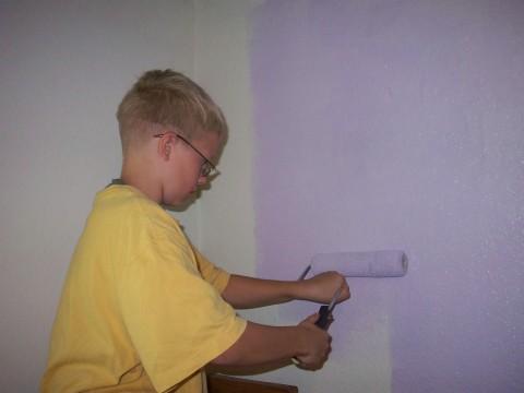 daniel puts on a coat of purple paint