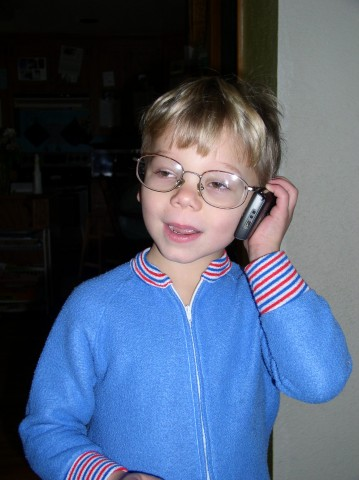David talking on the phone with Dad's glasses
