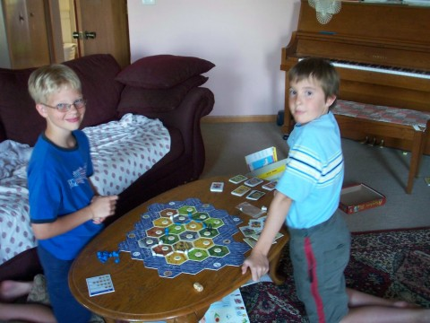 Daniel plays Settlers of Catan with a worthy opponent