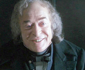 Michael Caine as Scrooge