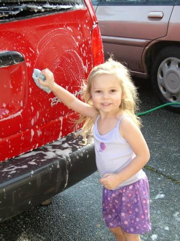 Sarah washes Mom's van